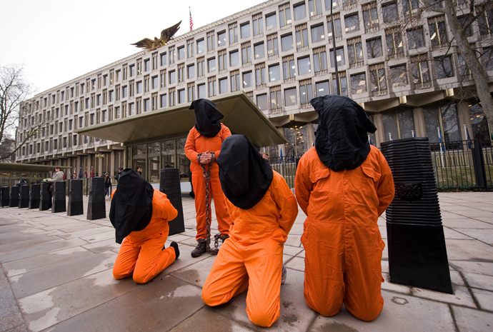 Protestors wear suits similar to those worn by detainees at Guantanamo Bay prison during a demonstration in central London (AFP Photo / Leon Neal)