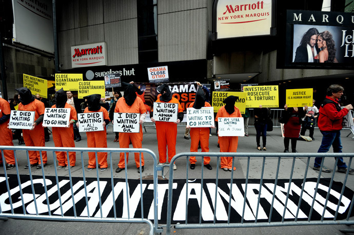 Activists demand the closing of the US military's detention facility in Guantanamo during a protest, part of the Nationwide for Guantanamo Day of Action, April 11, 2013 in New York's Times Square (AFP Photo / Stan Honda)