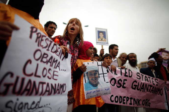 Human rights activists and relatives of Yemeni detainees at Guantanamo Bay prison shout slogans during a protest to demand the release of the detainees, outside the U.S. embassy in Sanaa June 17, 2013 (Reuters / Khaled Abdullah)
