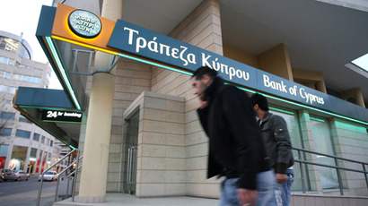 Cypriot bank workers rally outside parliament as cash hoarding begins