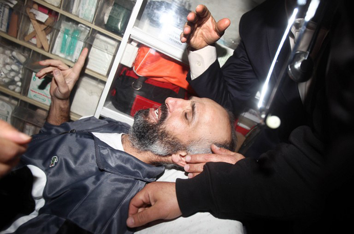 Ayman Sharawna, a Palestinian prisoner who was on long-term hunger strike, is pictured inside an ambulance upon his arrival at al-Shifa hospital in Gaza City on March 17, 2013. (AFP Photo / Mahmud Hams)