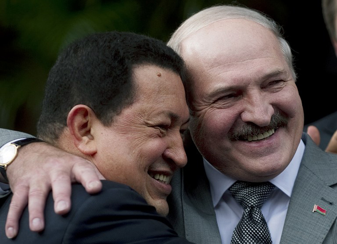 Venezuelan President Hugo Chavez hugs his Belarussian counterpart Alexander Lukashenko, during a meeting at Miraflores presidential palace in Caracas on June 26, 2012. (AFP Photo / Juan Barreto)