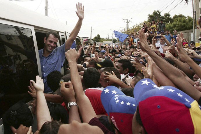 Venezuela's opposition leader and presidential candidate Henrique Capriles (L) greets supporters during a rally in Maracaibo March 17, 2013. (Reuters/Isaac Urrutia)