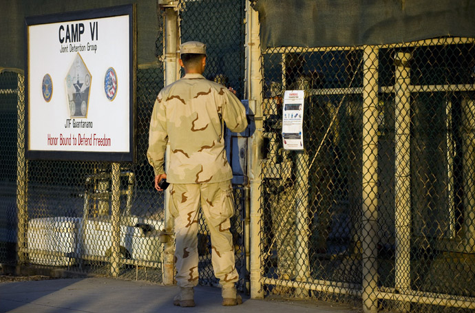 "This image reviewed by the US military shows a member of the military asking for enterance at the front gate of ""Camp Five"" and ""Camp Six"" detention facility of the Joint Detention Group at the US Naval Station in Guantanamo Bay, Cuba, January 19, 2012. (AFP Photo)"