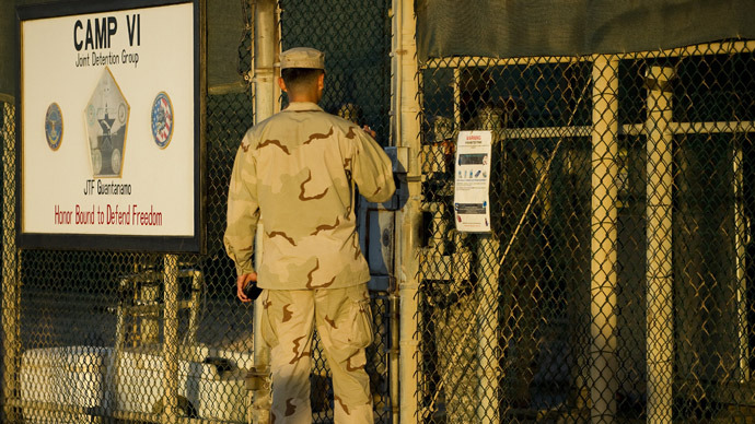 "This image reviewed by the US military shows a member of the military asking for enterance at the front gate of ""Camp Five"" and ""Camp Six"" detention facility of the Joint Detention Group at the US Naval Station in Guantanamo Bay, Cuba, January 19, 2012. (AFP Photo/Jim Watson)"