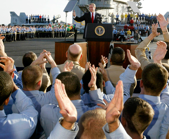 U.S. President George W. Bush addresses the nation and crew aboard the USS Abraham Lincoln while on an overnight visit to the aircraft carrier off the coast of California, May 1, 2003 (Reuters / Larry Downing)
