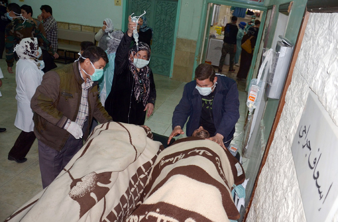 People are brought into a hospital in the Khan al-Assal region in the northern Aleppo province, as Syria's government accused rebel forces of using chemical weapons for the first time on March 19, 2013 (AFP Photo / HO-SANA)
