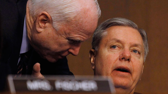 Senators John McCain (R-AZ) (L) and Lindsey Graham (R-SC) (R) confer at the Senate Armed Services Committee in Washington March 5, 2013.(Reuters / Gary Cameron)