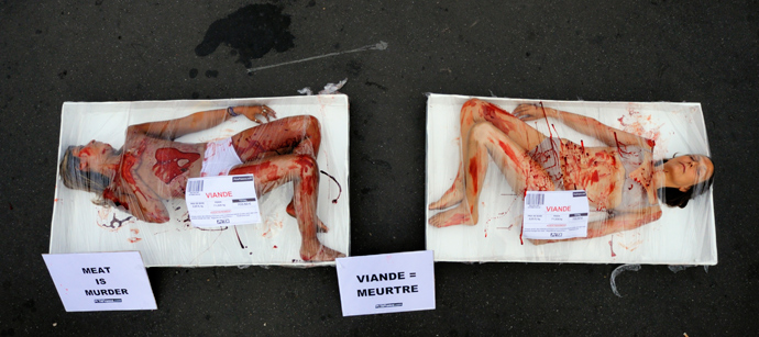 PETA (People for the Ethical Treatment of Animals) activists protest on a pavement in packaging labelled 'meat' in Paris (Reuters / Philippe Wojazer)