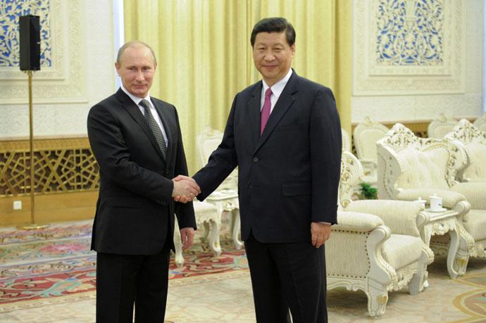 Russian President Vladimir Putin and Xi Jinping, June 6, 2012.(RIA Novosti / Alexsey Druginyn)