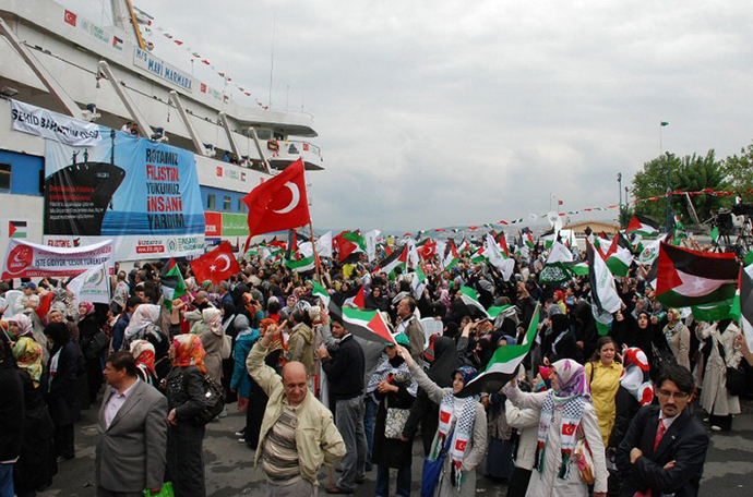 "File picture shows an image taken from the Free Gaza Movement website on May 28, 2010 of people sending off the Turkish ship Mavi Marmara taking part in the ""Freedom Flotilla"" heading towards the Gaza Strip. (AFP Photo)"