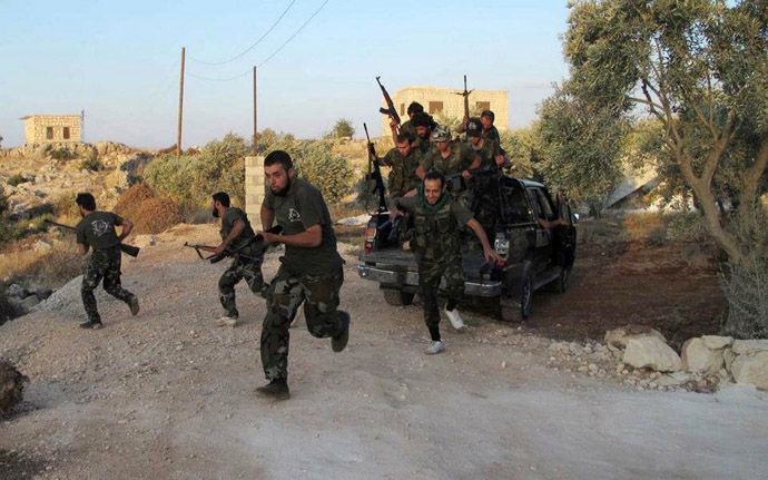 Free Syrian Army fighters from Katibat al-Farouk training on the outskirts of Idlib (AFP Photo/Shaam News Network)