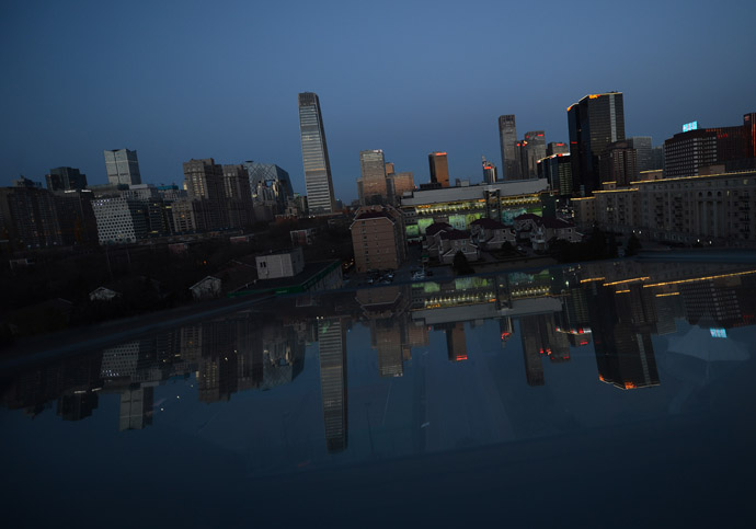 View of the Central Business District at sunset just before Earth Hour got underway in Beijing on March 23, 2013. (AFP Photo/Mark Ralston)