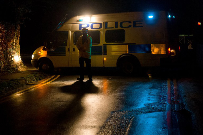 A police van blocks a road near the house of Russian tycoon Boris Berezovsky in Sunningdale, Berkshire, southwest of London, on March 23, 2013. (AFP Photo / Leon Neal)