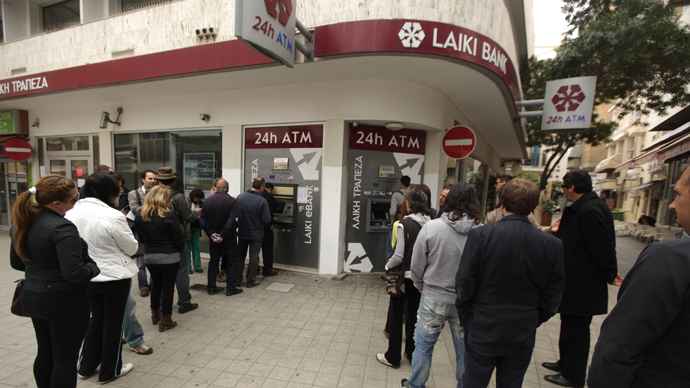 Cyprus reopens banks with strict limits on transactions