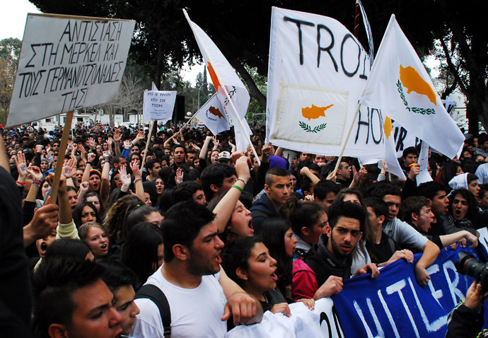 Cypriot students gather outside the parliament in Nicosia during a rally against a bailout for the financially crippled island on March 26, 2013.(AFP Photo / Emily Irving-Swift)
