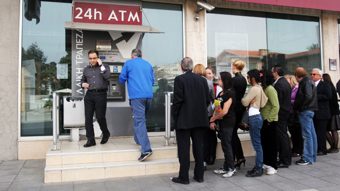 Cyprus toughens capital controls, steps up security ahead of banks reopening