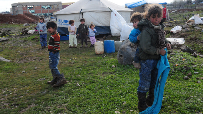 Turkish police fire teargas at Syrian refugees in camp protest