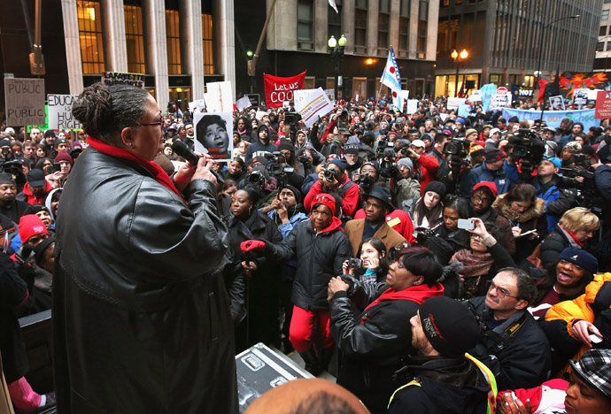 Chicago Teachers Union President Karen Lewis speaks to demonstrators protesting school closings on March 27, 2013 in Chicago, Illinois. About 2,000 protestors held a rally and marched through downtown to protest a plan by the city to close more than 50 elementary schools, claiming it is necessary to rein in a looming $1 billion budget deficit. (Scott Olson/Getty Images/AFP)