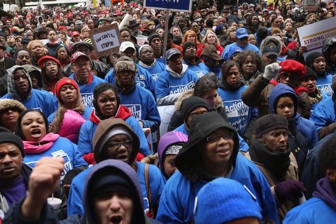 Demonstrators protest school closings on March 27, 2013 in Chicago, Illinois. More than 1,000 demonstrators held a rally and marched through downtown to protest a plan by the city to close more than 50 elementary schools, claiming it is necessary to rein in a looming $1 billion budget deficit. (Scott Olson/Getty Images/AFP)