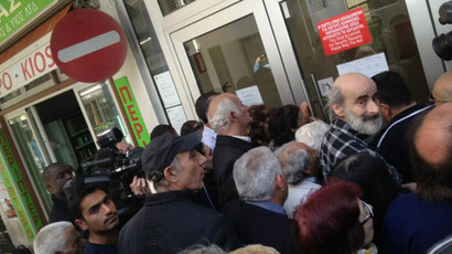 President slashes own wages as Cypriots face €300 daily cash limit