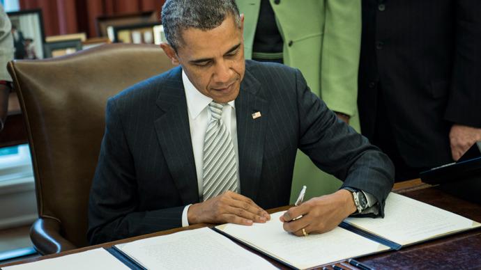 Résolutions HR-875 et les autres Obama-signs-monsanto-act.si