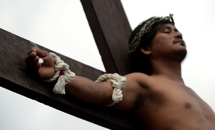 A penintent is nailed to a cross during the reenactment of crucifixion on Good Friday in the village of San Juan, San Fernando City, north of Manila on March 29, 2013 (AFP Photo / Noel Celis)