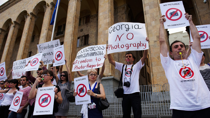 Georgia lifts photographers' Saakashvili-era espionage sentence