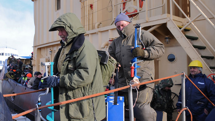 Fishermen leave a rescue ship at the Riga Port Authority on March 29, 2013 in Riga.(AFP Photo / Edijs Palens)