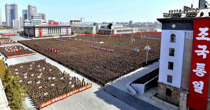 This photo taken on March 28, 2013 and released by North Korea's official Korean Central News Agency (KCNA) on March 29, 2013 shows North Korean leader Kim Jong-Un (front L) making a speech during the meeting of information workers of the whole army in Pyongyang (AFP Photo / KNS)