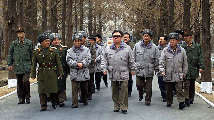Accompanied by military officials, North Korean leader Kim Jong-Il (C) walks during an inspection tour of the Academy of Logistic Officers of North Korea at an undisclosed location in North Korea, 10 February 2003.(AFP Photo / KCNA via Korean News Service)