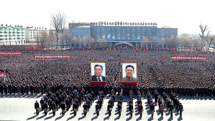 "North Korean citizens and soldiers attend a rally held to support ""The March 5 statement issued by a spokesman of the Supreme Command of the Korean People's Army"", in North Pyongang Province March 10, 2013.(Reuters / KCNA)"