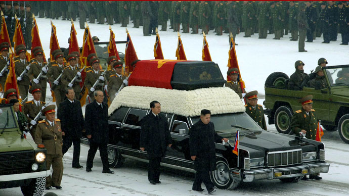 This handout picture taken by North Korea's official Korean Central News Agency (KCNA) on December 28, 2011 shows Kim Jong-Un (center R) and Jang Song-Thaek (C) besides the convoy carrying the body of his father and late leader Kim Jong-Il at Kumsusan Memorial Palace in Pyongyang. North Korean state television began broadcasting the funeral of late leader Kim Jong-Il December 28, with footage of tens of thousands of troops bowing their heads in the snow outside a memorial palace.(AFP Photo / KCNA)