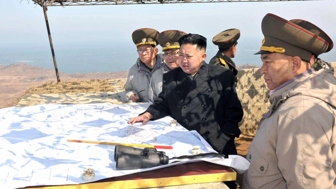 This undated picture, released from North Korea's official Korean Central News Agency on March 10, 2012 shows North Korean leader Kim Jong Un (C) inspecting Cho Islet defending a forward post on the west coast in North Korea.(AFP Photo / KCNA)