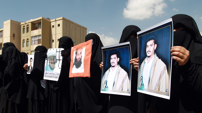 "Relatives of Yemeni inmates held in the US detention center ""Camp Delta"" at the US Naval Base in Guantanamo Bay, Cuba, brandish their portraits during a protest to demand their release, outside the American Embassy in Sanaa, on April 1, 2013 (AFP Photo / Mohammed Huwais)"