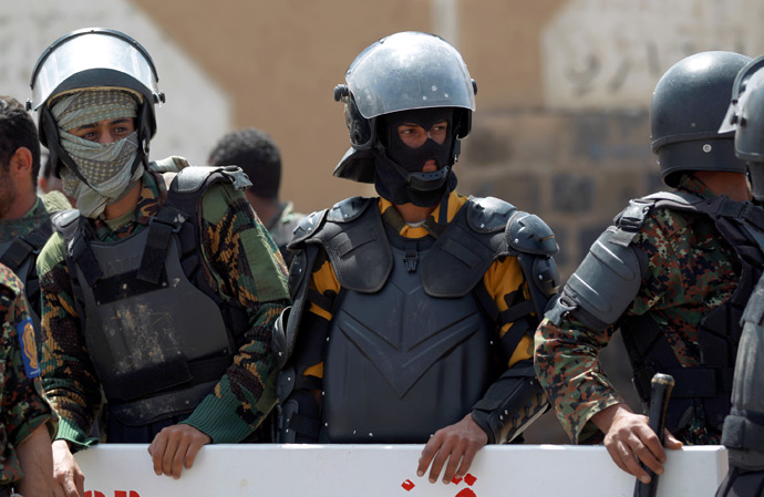 """Riot police secure the vicinity of the U.S. embassy, during a protest by relatives of Yemenis detained at the US detention center """"Camp Delta"""" at the US Naval Base in Guantanamo Bay, Cuba, during a protest to demand their release, in Sanaa, on April 1, 2013 (AFP Photo / Mohammed Huwais)"""