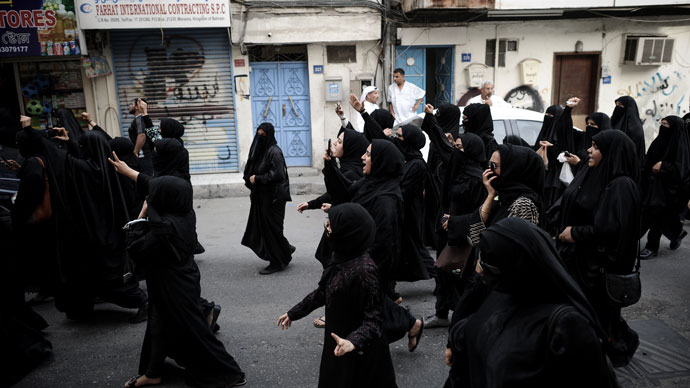 Bahraini women shout slogans as they march during an anti-regime rally in solidarity with jailed human rights activist Nabeel Rajab and against the upcoming Bahrain Formula One Grand Prix in Manama on March 29, 2013. (AFP Photo / Mohammed AL-Shaikh)