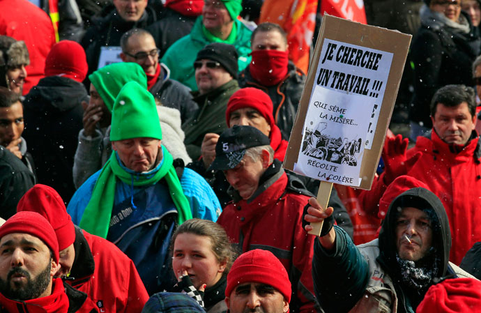 Workers and trade union representatives from all over Europe hold a demonstration against austerity near the European Commission and Council headquarters in Brussels March 14, 2013.(Reuters / Yves Herman)