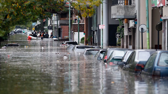 Submerged cars are seen in a flooded street after a rainstorm in Buenos Aires April 2, 2013. (Reuters / Enrique Marcarian)