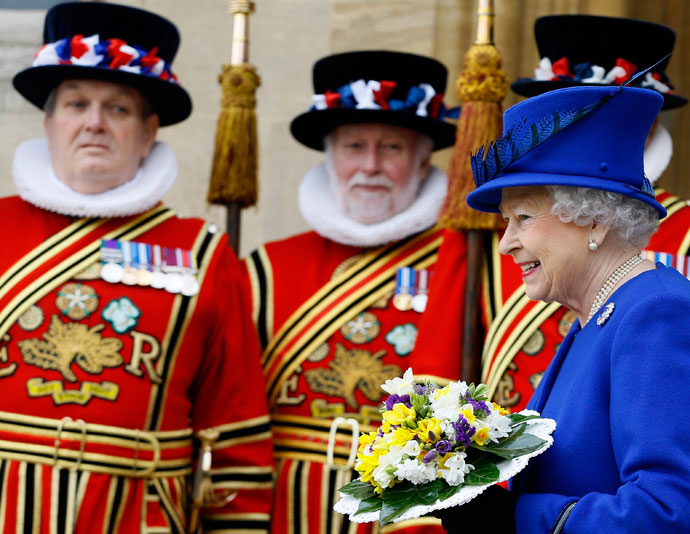 Britain's Queen Elizabeth II (R) smiles as she walks past Yeomen of the Guard after attending the Maundy service at Christ Church Cathedral in Oxford, on March 28, 2013.(AFP Photo / Kirsty Wigglesworth)