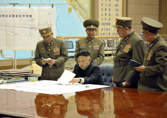North Korean leader Kim Jong-un (C) presides over an urgent operation meeting on the Korean People's Army Strategic Rocket Force's performance of duty for firepower strike at the Supreme Command in Pyongyang, early March 29, 2013 (Reuters/KCNA)