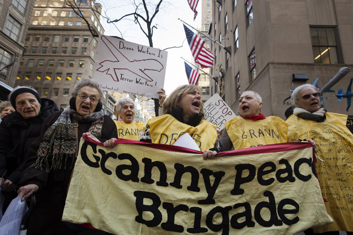 """Members of the group """"Grandmothers Against the War"""" hold signs as they protest against the use of drone strikes by the U.S. government in New York April 3, 2013. (Reuters)"""