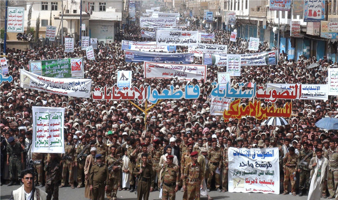n this handout picture distributed by the press office of Yemen's Zaidi rebels, also known as Huthis, residents of the northern Yemeni province of Saada, where only one polling station was open, protest against participation in the presidential elections on February 21, 2012. (AFP Photo)