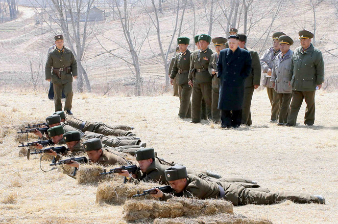 This photo taken on March 23, 2013 and released by North Korea's official Korean Central News Agency (KCNA) on March 24 shows North Korean leader Kim Jong-Un (4th R-in blue) inspecting the second battalion under Korth Korean army Unit 1973 at an undisclosed location. (AFP Photo/KCNA via KNS)