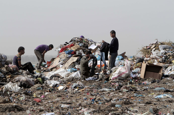 Palestinians go through a pile of garbage in search of recyclable material in Rafah in the southern Gaza Strip on April 3, 2013. (AFP Photo/Said Khatib)