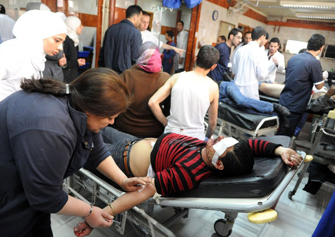 Wounded people being treated in the emergency room of a hospital following an alleged mortar attack that hit the Baramkeh district of Damascus on March 26, 2013. (AFP Photo / SANA)