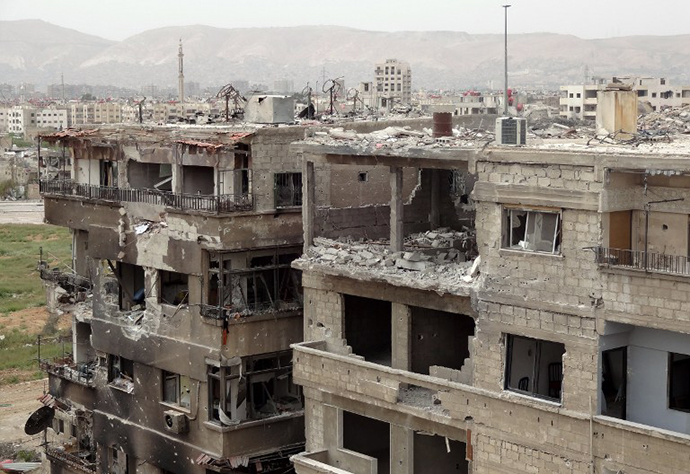 Heavily damaged buildings in Zamalka, a suburb of Damascus, on March 31, 2013. (AFP Photo / Shaam News Network)