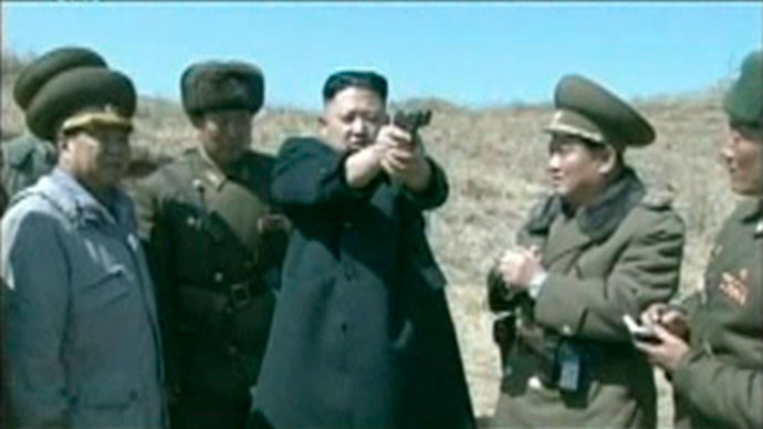 North Korea's leader Kim Jong-un holds up a pistol as he supervises pistol and automatic file firing drills at the second battalion under North Korea People's Army (KPA), in this still image taken from video footage released on April 5, 2013.(Reuters / KRT via Reuters Tv)