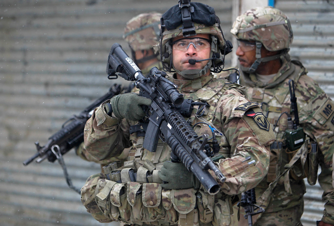 U.S. troops with the International Security Assistance Force (ISAF) keep watch at the site of a suicide attack in Kabul, February 27, 2013 (Reuters / Omar Sobhani)