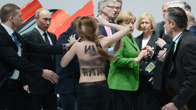 swearing bare breasted activists rush at putin and merkel. Black Bedroom Furniture Sets. Home Design Ideas